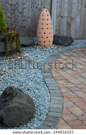 Garden design, with hard landscaping, using shaping, paving, rocks and pebbles - stock photo