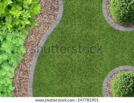 Garden detail in aerial view with bark compost - stock photo