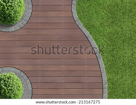 garden detail in aerial view with wooden terrace - stock photo