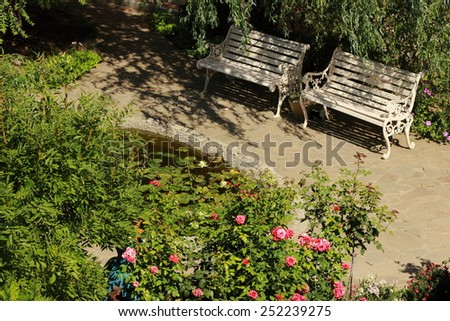 Garden displaying annual and perennial gardens in full bloom. - stock photo