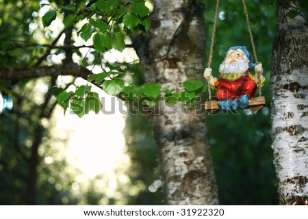 garden dwarf on green nature background - stock photo