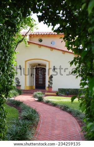 Garden entrance to a house - stock photo