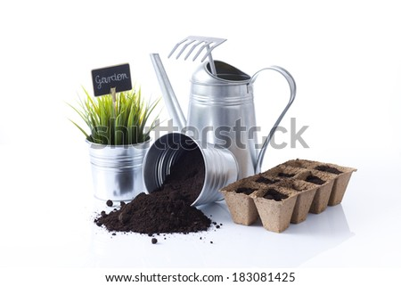 garden equipment including pots and watering cane - stock photo