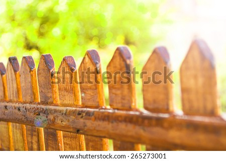 garden fence with a empty sign  - stock photo