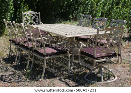 Garden Furniture In The Garden, Marble Table And Chairs.