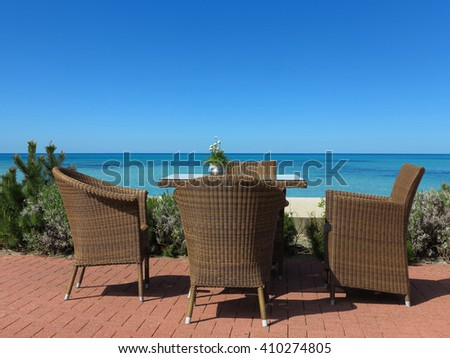 garden furniture suite on terrace with a view to the sea - stock photo