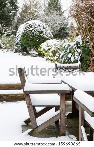 Garden furniture under snow - stock photo