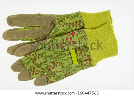 Garden gloves with leather palm - closeup isolated on white  - stock photo