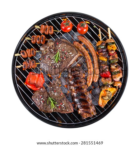 Garden grill with meat and vegetable, isolated on white background - stock photo