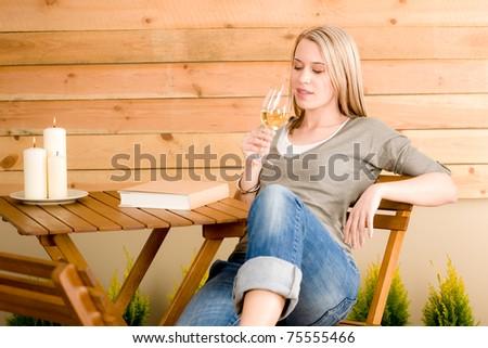 Garden happy woman enjoy wine rest patio - stock photo