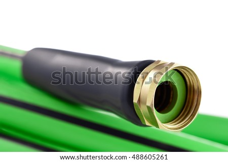 Garden hose brass nozzle close-up on white background