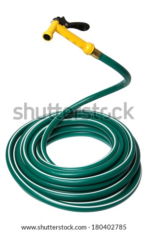 Garden Hose coiled with yellow handle  - stock photo