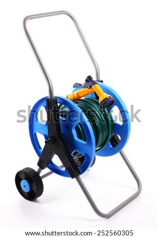 Garden hose on wheels isolated on white - stock photo