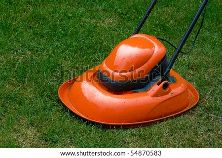 Garden hover lawn mower on grass