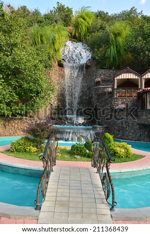 Garden landscape with waterfall - stock photo