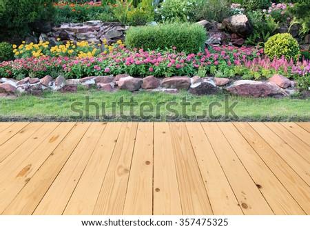 Garden landscape with wood floor - stock photo