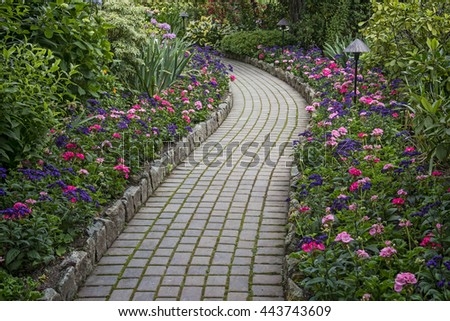 Garden landscaping with lighting and stone pathway