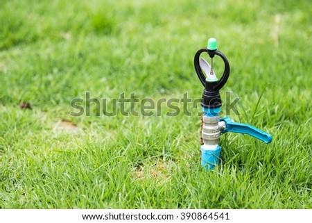 Garden lawn water sprinkler - stock photo