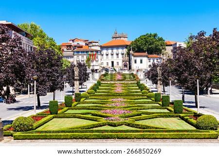 Garden near Nossa Senhora Da Consolacao E Dos Santos Passos Church (Sao Gualter Church) in Guimaraes, Portugal - stock photo