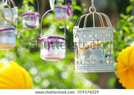 Garden party decoration hanging on branch - stock photo
