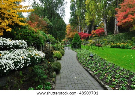 Garden path inside the historic butchart gardens (over 100 years in bloom), victoria, british columbia, canada