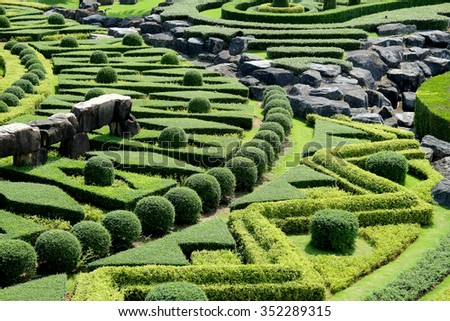 Garden path with topiary landscape - stock photo