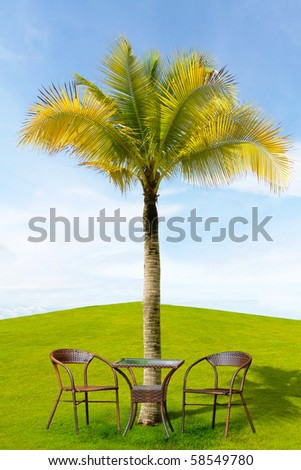 Garden patio with table and chairs - stock photo