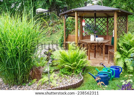 Garden pavilion by the pond - stock photo