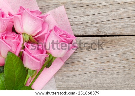 Garden pink roses bouquet over wooden table. Top view with copy space - stock photo