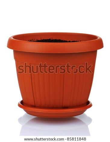 Garden plastic pot with soil on a white background - stock photo