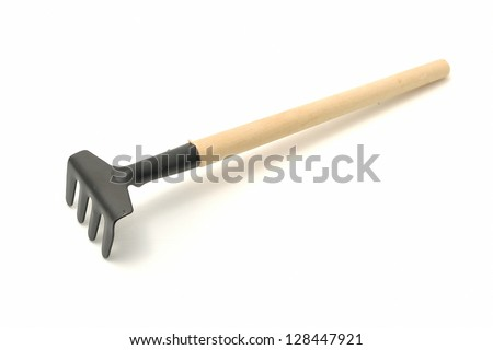 Garden rake is isolated on a white background - stock photo