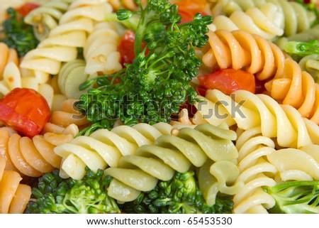garden rotini salad with broccoli and tomatoes closeup - stock photo