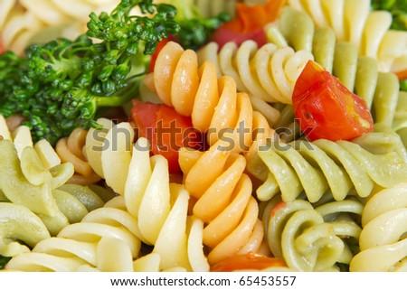 garden rotini salad with broccoli and tomatos closeup - stock photo