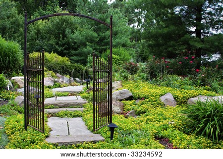 Garden scene with iron gate.