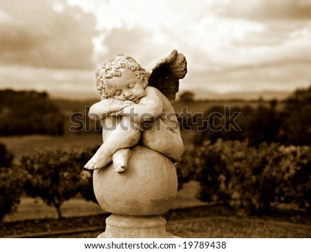 Garden Sculpture in Sepia - stock photo