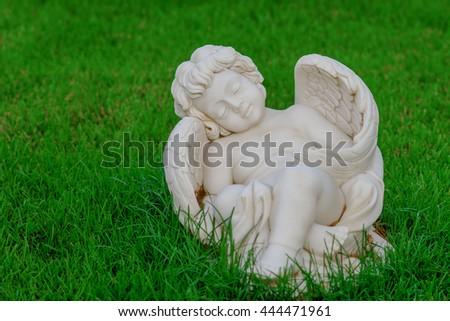 "Garden sculpture ""Little Sleep Angel"" - stock photo"