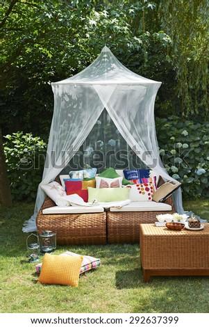 garden sofa pillow concept  - stock photo