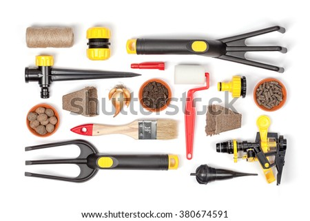 garden tools and essentials on white background top view. gardening flat lay concept - stock photo