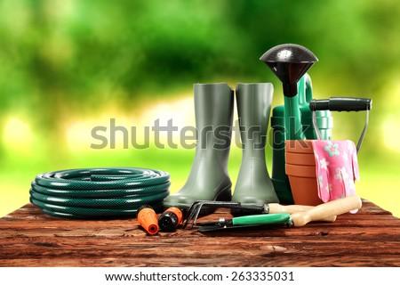garden tools and green wellington  - stock photo