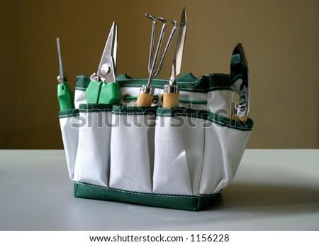 Garden tools in the bag - stock photo