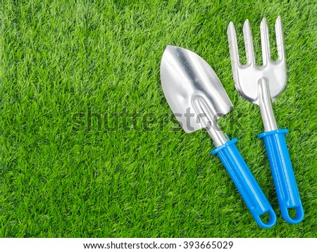 garden tools on grass background. - stock photo