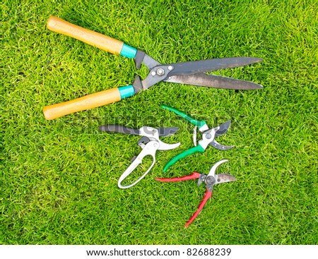 Garden Tools on the green grass - stock photo