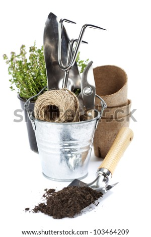 garden tools (shovel,  rake, pruner, cord and peat pots ) over white - stock photo