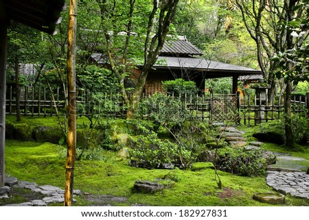 Garden view of a classic country Japanese home. - stock photo
