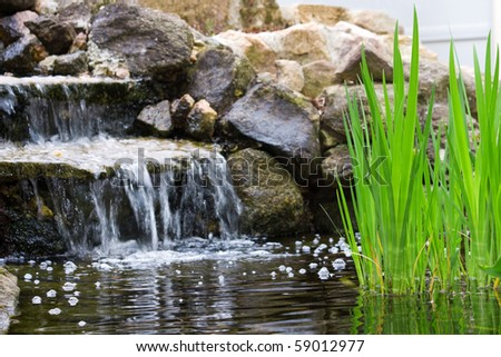 Garden waterfall - stock photo