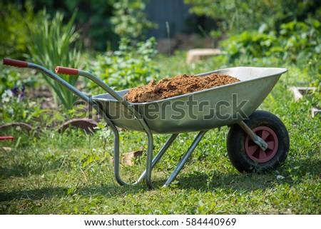 Garden Wheelbarrow Filled With Soil On A Farm