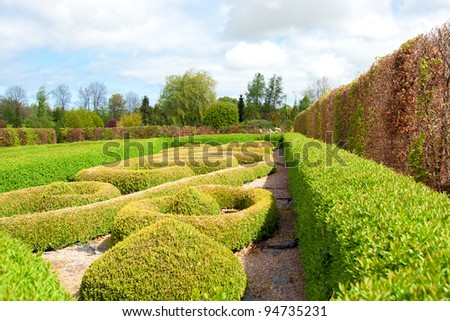 Garden with Topiary Landscaping - stock photo