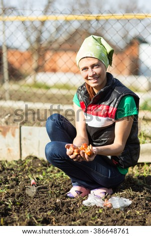 Garden Works. Young Woman Working in the Garden. Healthy Lifestyle - stock photo