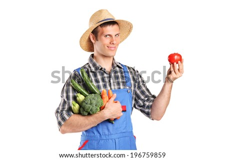 Gardener holding a bunch of vegetables and a single tomato isolated on white background