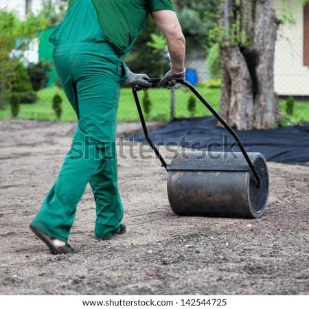 Gardener is preparing ground for planting - stock photo